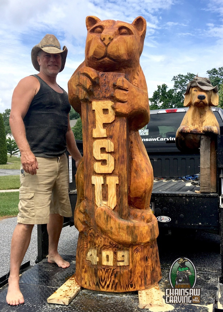 Chainsaw carving by paul logos